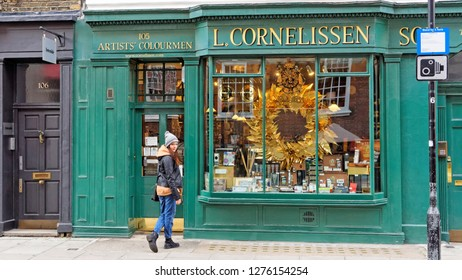London. Girl before entering the art shop 'L. Cornelissen & Son' on Great Russell St, Bloomsbury, December 27, UK 2018