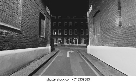 London Gower Mews by night , Perspective photo of narrow street, Georgian architecture in Black and White Tone