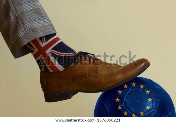 London, Great Britain 1.12.2019: Brexit European Union and Britain political game. London elegance man flag voting Brexit. United Kingdom European union flags in football match.