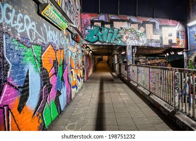 LONDON, GREAT BRITAIN - 18th of January 2014:Unknown artist painting graffiti and pedestrians on the Leake Street in LONDON, GREAT BRITAIN on 18th of January 2014