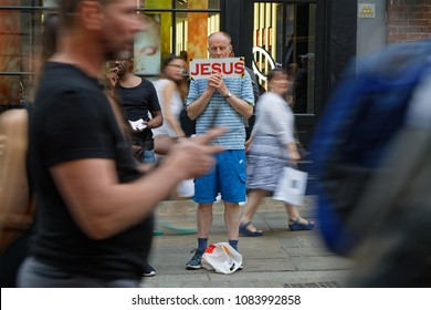 LONDON, GREAT BRITAIN, April 21, 2018 : Jehovah's Witnesses in the street among the crowd. They are best known for their door-to-door preaching distributing literature