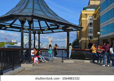 "London, Great Britain - August 01, 2015: Photographing tourists at a pavilion next to the museum ship ""Belfast"" with a view of the Tower Bridge in London on a sunny day"