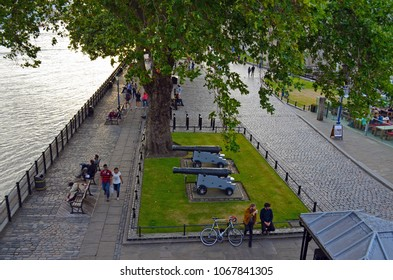 London, Great Britain - August 1, 2015: Promenade at the Thames with people, who relax at the end of the day near the tower of London