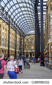 London, Great Britain - August 1, 2015: View of a historic former dock, which has been restored and now offers space for small shops and restaurants.