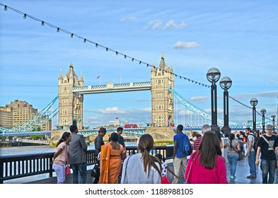 London, Great Britain - August 1, 2015: View to the Towerbridge in London with tourists in the foreground.