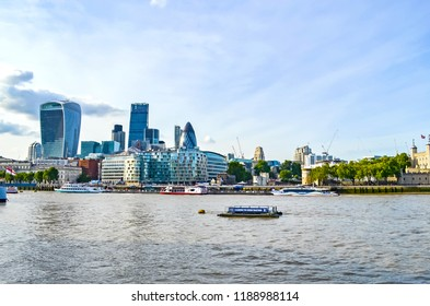 London, Great Britain - August 1, 2015: View over the River Thames on modern skyscrapers next to the Tower of London.