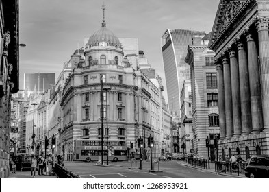 London, Great Britain - August 1, 2015: Black and white photo from the traffic at the street corner Cornhill/Lombard St in the bank district of London near the Bank Underground Station in the dusk.
