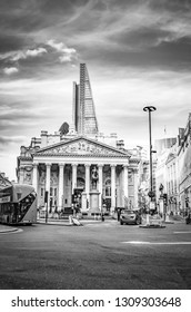 London, Great Britain - August 1, 2015: Black and white photo from the traffic at a street corner in the bank district of London.