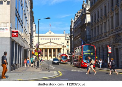 London, Great Britain - August 2, 2015: View to the bus station Charles II Street near Regent Street with a typical red bus and pedestrians. In the background you can see the Theatre Royal Haymarket.