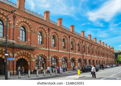 London, Great Britain - August 2, 2015: Historical facade of the station St. Pancras in London with passengers in the foreground.