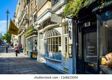 London, Great Britain - August 2, 2015: Sidewalk in the city of London with many small shops.
