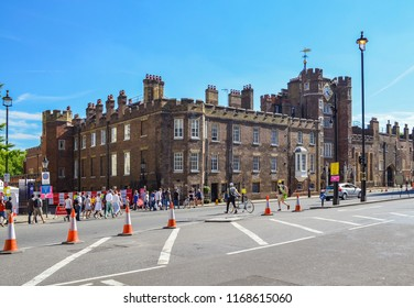 London, Great Britain - August 2, 2015: Street with people in front of a historic building in London, which is cordoned off for a bicycle race.