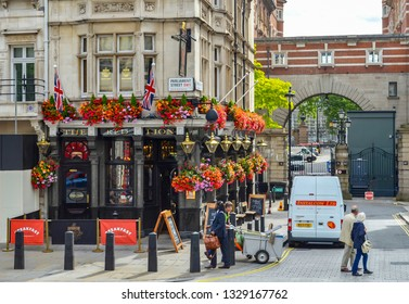 London, Great Britain - August 3, 2015: Historic facade of a residential building in London, UK, with a beautifully decorated shop on the ground floor.