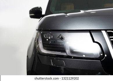 London, Great Britain - February 22, 2019: New Land Rover Range Rover luxury SUV cars, front radiator and headlight close up