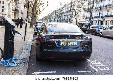 London, Great Britain  - January 3, 2018: Electric car Tesla Model S recharging the batteries on a street in London, Great Britain