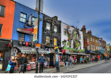 LONDON, GREAT BRITAIN, JUNE 3: HDR image of tourists walking along the colorful houses and shops in Camden Town near the Camden Town on blue sky, London, UK, June 3, 2019