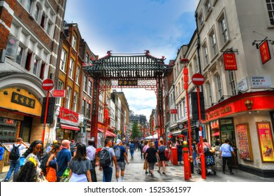 LONDON, GREAT BRITAIN, JUNE 9: HDR image of tourists walking at Chinatown in the Soho area of the City of Westminster on blue sky, London, UK, June 9, 2019