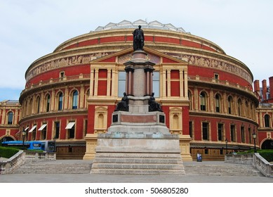 LONDON, GREAT BRITAIN - MAY 21, 2014. Royal Albert Hall in London, with statues, buses and stairs.