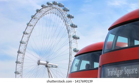 London, Great Britain - May 22 2019: The front of two doubledecker busses in front of the attraction London Eye. One of them with the sign Trafalgar Square.