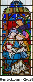 LONDON, GREAT BRITAIN - SEPTEMBER 14, 2017: The Nativity of Jesus Christ on the stained glass in the church St. Michael Cornhill by Clayton and Bell from 19. cent.