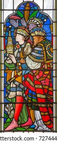 LONDON, GREAT BRITAIN - SEPTEMBER 14, 2017: The detail of Adoration of Magi on the stained glass in the church St. Michael Cornhill by Clayton and Bell from 19. cent.