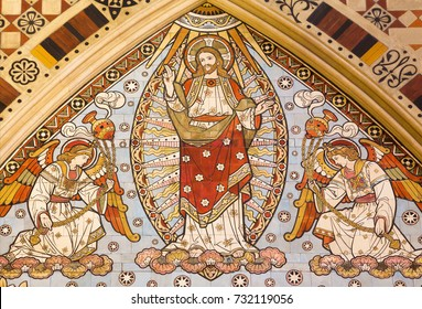 LONDON, GREAT BRITAIN - SEPTEMBER 15, 2017: The detail of tiled mosaic of Ascension of the Lord in church All Saints designed by Butterfield and painted by Alexander Gibbs (1873).
