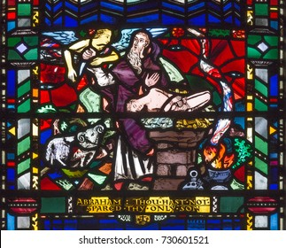 LONDON, GREAT BRITAIN - SEPTEMBER 16, 2017: The stained glass of Abraham Offers Isaac on Mt. Moriah  in church St Etheldreda by Charles Blakeman (1953 - 1953).
