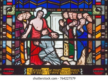 LONDON, GREAT BRITAIN - SEPTEMBER 16, 2017: The scene apparition of Jesus to umbelive Thomas on the stained glass in church St Etheldreda by Charles Blakeman (1953 - 1953).
