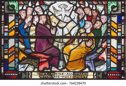 LONDON, GREAT BRITAIN - SEPTEMBER 16, 2017: The scene of Pentecost on the stained glass in church St Etheldreda by Charles Blakeman (1953 - 1953).