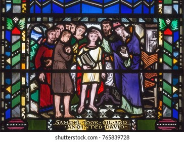 LONDON, GREAT BRITAIN - SEPTEMBER 16, 2017: The scene of the Anointing of David by Samuel on the stained glass in church St Etheldreda by Charles Blakeman (1953 - 1953).