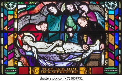 LONDON, GREAT BRITAIN - SEPTEMBER 16, 2017: The scene of the Burial of Jesus on the stained glass in church St Etheldreda by Charles Blakeman (1953 - 1953).