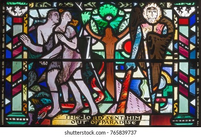 LONDON, GREAT BRITAIN - SEPTEMBER 16, 2017: The Expulsion of Adam and Eve from Paradise on the stained glass in church St Etheldreda by Charles Blakeman (1953 - 1953).