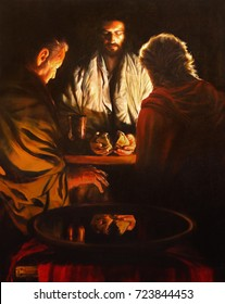 LONDON, GREAT BRITAIN - SEPTEMBER 18, 2017: The painting of the scene Jesus and the Disciples of Emausy in the church of Immaculate Conception, Farm Street from 20 cent.