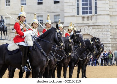 LONDON, GREAT BRITAIN - SEPTEMBER 19, 2014:  This is a detachment of equestrian royal guardsmen, built to change the guard at the Horse Guards.