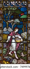 LONDON, GREAT BRITAIN - SEPTEMBER 19, 2017: The Parable of the Sower on the stained glass in St Mary Abbot's church on Kensington High Street.