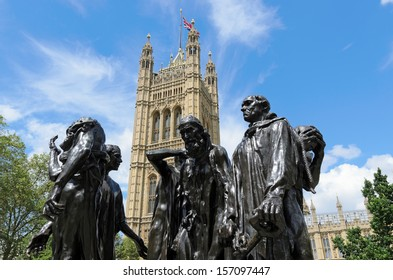 LONDON, GREATER LONDON, ENGLAND - JUNE 30: Les Bourgeois de Calais sculpture by Auguste Rodin  completed in 1889 and Victoria Tower on June 30, 2012 in London, Greater London, England.
