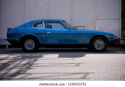 London, Greater London/ UK - 24 06 2018: Side profile shot of a classic blue Datsun 260z parked on a street