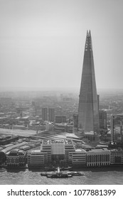 London, Greater London / UK - September 20 2016: The Shard and London Bridge Station seen from Sky Garden with Thames and docks in black and white