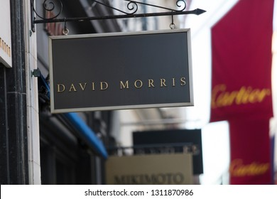 London, Greater London, United Kingdom, 7th February 2018, A sign and logo for David Morris store on Bond Street