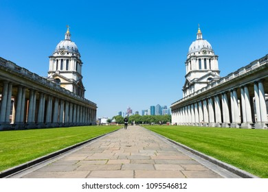 London, Greenwich, UK - May 15th, 2018: University of Greenwich famous towers, taken from Pepys walk. The sky is blue.