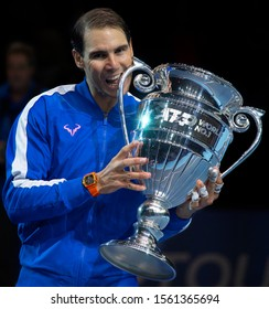 London, Greenwich / United Kingdom - 11.15.2019: Rafael Nadal with The 2019 ATP Tour Year-End Number One trophy on centre court at the O2 Arena.