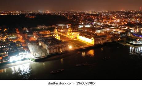 London, Greenwich / United Kingdom - March 15 2019: Aerial drone night shot of famous Greenwich University