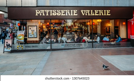 London Hammersmith, UK - Feb 7, 2019: Diners through a window at Patisserie Valerie cafe in Hammersmith, London, which recently collapsed into administration, potentially due to fraud