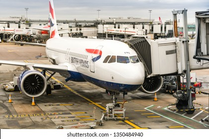 LONDON HEATHROW AIRPORT, ENGLAND - FEBRUARY 2019:  New British Airways Airbus A320 Neo short-haul jet attached to a passenger jetty at Terminal 3 at London Heathrow Airport