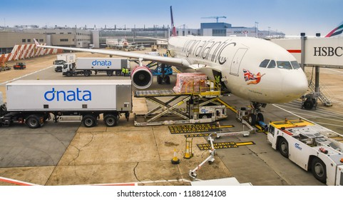 LONDON HEATHROW AIRPORT - JUNE 2018: Wide angle view of air feight being loaded into the cargo hold of a Virgin Atlantic Airbus A330 at London Heathrow Airport.