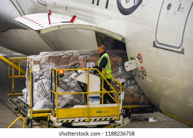 LONDON HEATHROW AIRPORT - JUNE 2018: Close up view of an air freight pallet being loaded into the cargo hold of a Virgin Atlantic Airbus at London Healthrow airport.