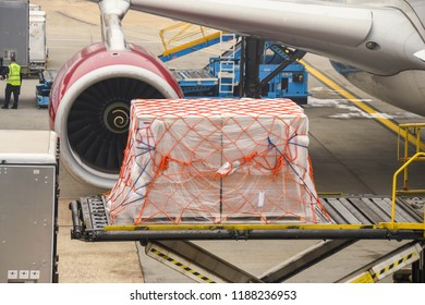 LONDON HEATHROW AIRPORT - JUNE 2018: Air feight pallet wrapped in plastic being loaded into the cargo hold of a Virgin Atlantic Airbus A330 at London Heathrow Airport.
