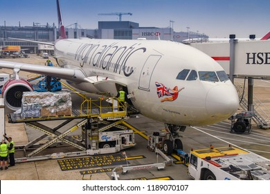 LONDON HEATHROW AIRPORT - JUNE 2018: Air feight pallet being loaded into the cargo hold of a Virgin Atlantic Airbus A330 at London Heathrow Airport.