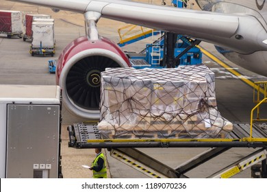 LONDON HEATHROW AIRPORT - JUNE 2018: Close up view of an air feight pallet being loaded into the cargo hold of a Virgin Atlantic Airbus A330 at London Heathrow Airport.