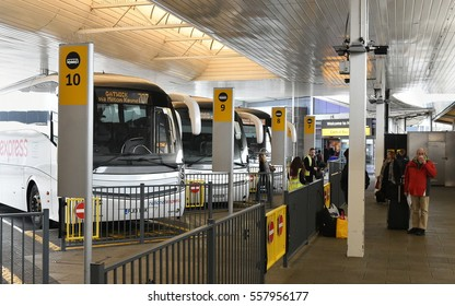 London Heathrow Airport, UK - December 2, 2016: National Express coaches sit parked in Heathow Airport's Central Bus Terminal. The bus station is open 24 hours a day serving terminals 1 through to 5.